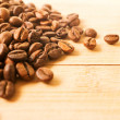 Stock Photo: Coffee beans on wood background