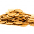 A pile of gold coins isolated — Stock Photo #42787409