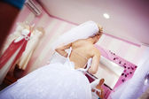 The bride is trying on wedding dress — Stock Photo