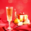 Glass of champagne against Christmas decorations — Stock Photo