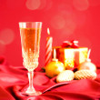 Glass of champagne against Christmas decorations — Stock Photo #19373775
