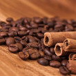 Coffee beans with cinnamon — Stock Photo