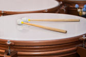 Drum sticks lying on the timpani — Stock Photo