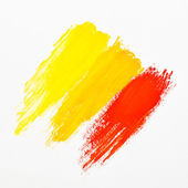 Dabs of red, orange and yellow paint — Стоковое фото