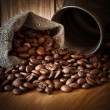 Coffee beans spilled out of the bag — Stock Photo