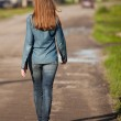 The back is a girl walking down — Stock Photo #36281519