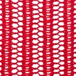Knitted red pattern in a grid — Stock Photo