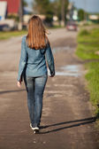 The back is a girl walking down — Stock Photo