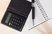 Calculator with notepad and pen — Stok fotoğraf