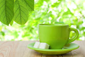 Green tea cup on a wooden table — Stock Photo