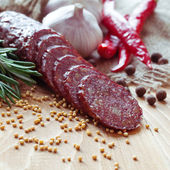 Smoked sausage with spices — Stock Photo