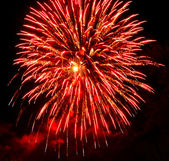 Red and black abstract background Fireworks on the sky — Stock Photo