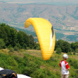 Looking to yellow paraglider. — Stock Photo