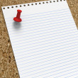 Royalty-Free Stock Photo: Blank lined notepaper with red pushpin