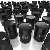 High angle view of many black oil barrels — Stock Photo