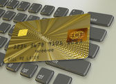 Gold credit card with two golden globes — Stock Photo