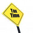 Stop sign with tax time reminder message — Stock Photo