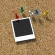 Corkboard with pushpins and polaroid print — Stock Photo #25078289