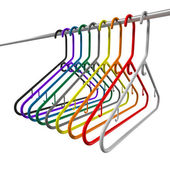 Colored plastic coat hangers chrome bar — Stock Photo