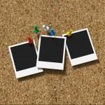 Corkboard with pushpins and three polaroid prints — Stock Photo #26178271