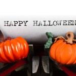 Typewriter with text happy halloween — Stock Photo #12575443