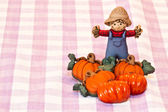 Pumpkins and scarecrow — Stock Photo