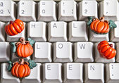Pumpkins and happy halloween — Stock Photo