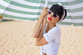 A beautiful young girl in retro look with red lips in a white sw — Stock Photo