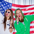 Beautiful patriotic girls with lollipop — Stock Photo