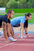 Man and woman on the starting line — Stock Photo
