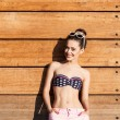 Beautiful gsexy girl poses against wooden wall — Stock Photo #34991365