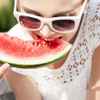 Girl in white summer dress eat watermelon — Stock Photo