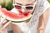 Girl in white summer dress eat watermelon — Stock Photo
