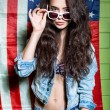 Beautiful sexy long haired girl against american flag — Stok fotoğraf #35751905