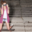 Beautiful sexy lady in jeans shorts with skateboard and to-go cup — Foto Stock