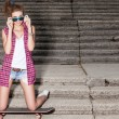 Beautiful sexy lady in jeans shorts with skateboard and to-go cup — Stok fotoğraf
