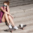 Beautiful sexy lady in jeans shorts with skateboard and to-go cup — Stock Photo