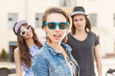 Beautiful young people on city background — Stock Photo
