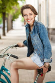 Woman on city bike — Stock Photo