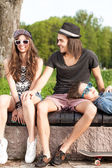 Beautiful young people having fun in city park — Stock Photo
