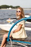 Beautiful girl at sea pier — Stock Photo