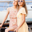 Two beautiful girls at sea pier — Foto Stock