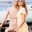Two beautiful girls at sea pier — Stok fotoğraf