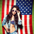 Beautiful sexy long haired girl against american flag — Stok fotoğraf