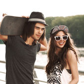 Beautiful couple walking in city park — Stock Photo