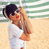 A beautiful young girl in retro look with red lips in a white sw — ストック写真