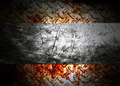 Metal plate over grunge rusted background — Zdjęcie stockowe