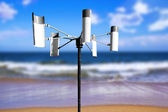 Wind energy generator set up on a beach shore — Stock Photo