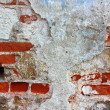 Old brick wall with cracked plastering background horizontal — Stock Photo