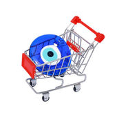 Evil eye bead in shopping cart isolated on white background — Stock Photo